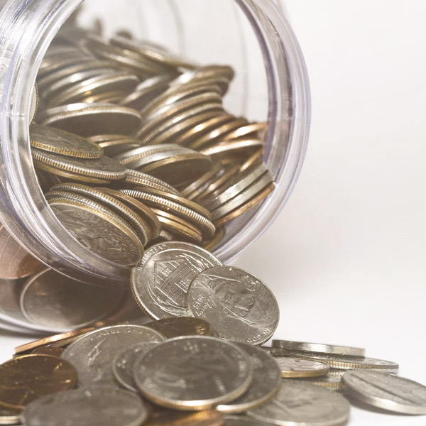 Jar of coins representing the money that can be saved by following Chelsea Galicia's 10 money management tips