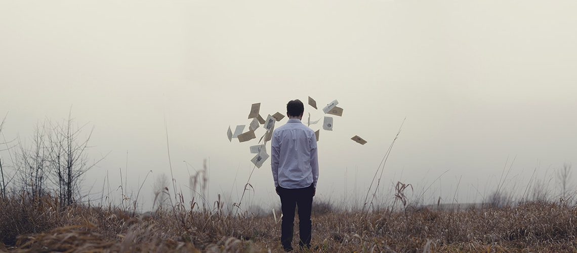 Man with papers in the air because he understands business but not how to manage money properly as an entrepreneur